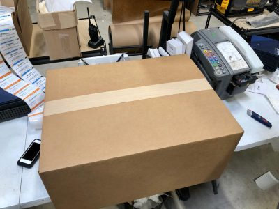 Seal your box of toner cartridges with two-inch packing tape. Don't forget the shipping label!